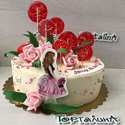 торт с фигуркой девочки и леденцами